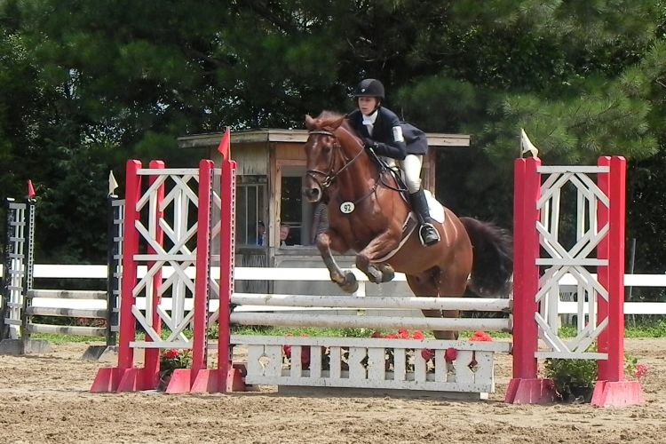 Gabbie takes a fence at USPC Champs